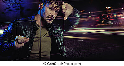 Angry look of handsome man wearing leather jacket - Angry...