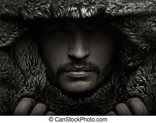 Portrait of a young man in fur hood - Portrait of a young...