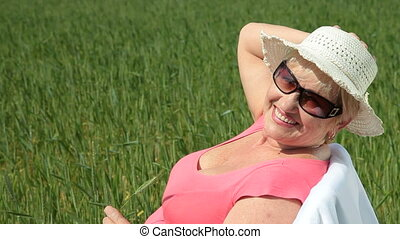 Happy elderly woman outdoors - Happy elderly woman enjoying...
