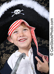Pirate boy - Smiling young boy wearing a pirate costume
