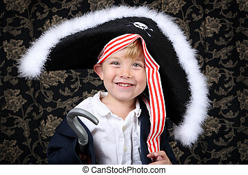 Pirate boy - Young boy smiling wearing a pirate costume