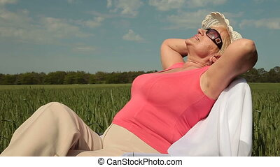Peaceful and Secure Old Age - Senior woman relaxing on a...