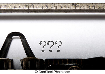 Writers block - Three question marks printed on a typewriter...