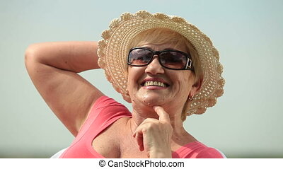 Face of happy senior woman outdoors