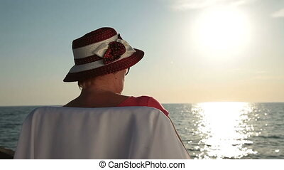 Senior woman vacation - Senior woman enjoying summer...