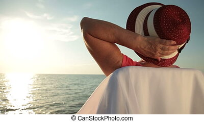 Senior Woman on the Beach - Senior woman enjoying summer...