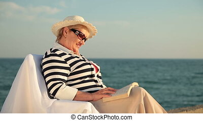 Senior lady relaxing on the seacoas