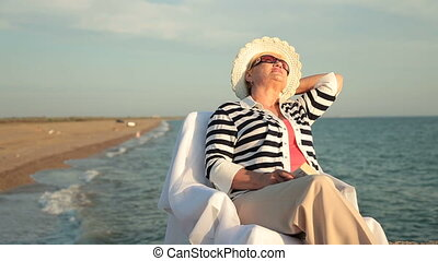 Happy senior woman at the seaside - Happy retired woman...