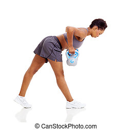 young black woman doing kettle bell weight exercise