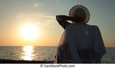 Senior woman silhouette by sea - Senior woman enjoying...