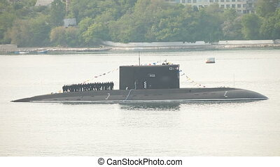 Moored submarine in harbor, crew on deck Celebration of the...