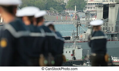 Russian sailors crew, in the background moored missile...