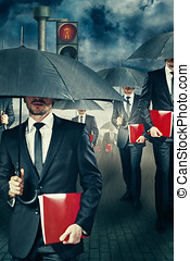 The rush - Businessman with umbrella in the rain