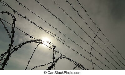 Barbed wire and razor wire fencing