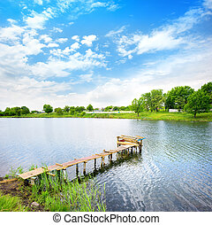 Lough - Wooden dock, pier, on a lake in summer sunny day