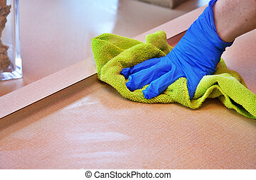 cleaning chores - closeup of hand with purple latex glove...