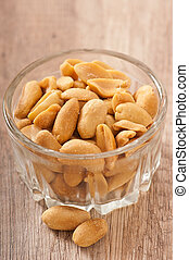 peanuts in a bowl on wooden table