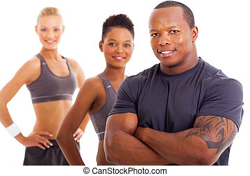 handsome male personal trainer and team - close up portrait...