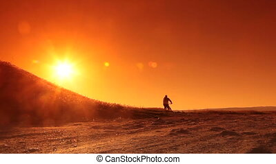 Man Cycling at Sunrise