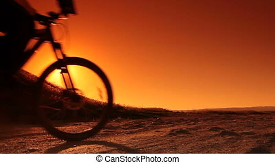 Man on Bike at Sunrise - Male Silhouette on Bike at Sunrise