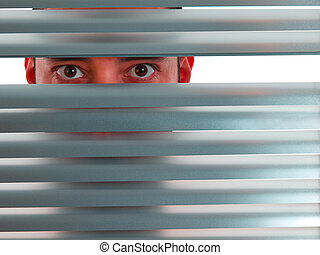Red peeping Tom - A red man looks to the camera through the...