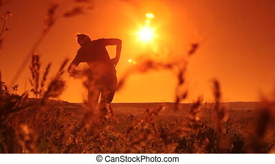 Woman Doing Exercises At Sunrise