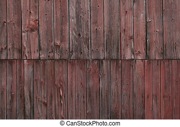 The side of a weathered barn. - Closeup side of a weathered...