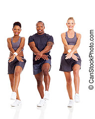 group of fit people working out on white background
