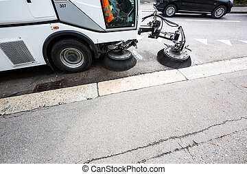 Detail of a street sweeper machinecar cleaning the road