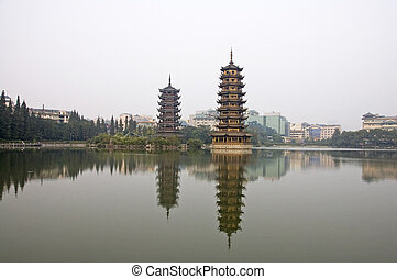 Twin pagodas in Guilin - Twin pagodas reflected in the...
