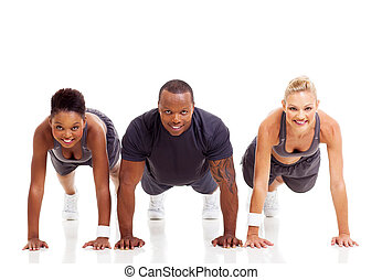 group of fit people doing pushups on white background