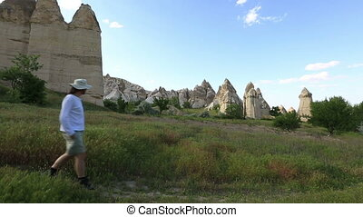 cappadocia - Tourist watching cave house Famous city...