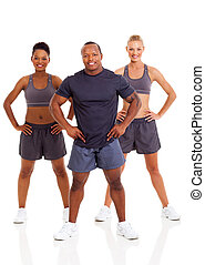 fit young people posing on white background