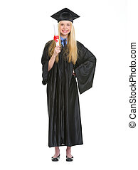 Full length portrait of young woman in graduation gown showing diploma