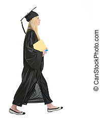 Young woman in graduation gown with books going sideways