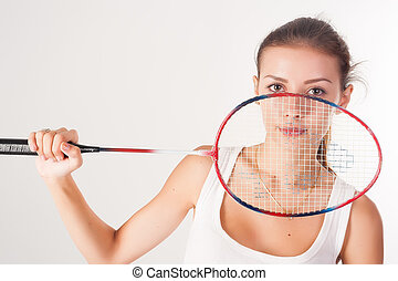 Beautiful girl with a racket in hands - Pretty fit woman...
