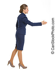 Full length portrait of happy business woman stretching hand...
