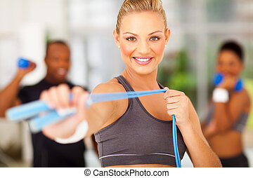 woman exercise in gym with jumping rope