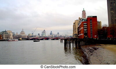 pan across the river thames from the south bank, capturing...