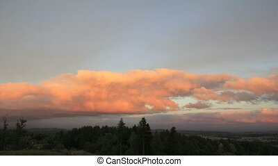 Sunset with Moving Cumulus Clouds over Happy Valley Oregon...