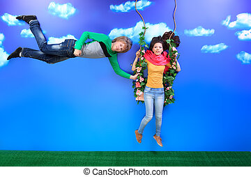 teeter together - Couple of young people in love flying in...