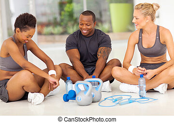 group of people relaxing after exercise - group of people...