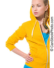 Modern teenager girl in sweater with draped hood looking on...