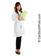 Nursing student standing isolated. Full body young Asian...
