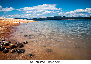 lake jocassee shore on a bright sunny day