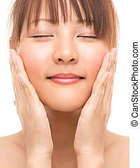 Facial massaging - Facial massage Asian skincare woman...