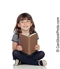 Adorable little girl with a book reading