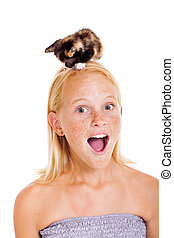 little kitten sitting on teen girl's head - little pet...