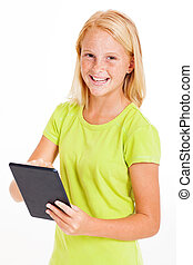 pre teen girl using tablet computer - happy pre teen girl...