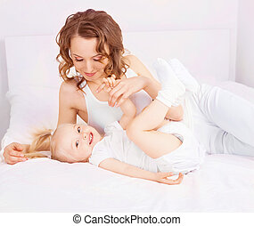 mother and daughter - happy mother and her two year old...